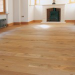 Engineered wooden floor large room with fireplace